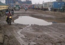 Funds stall repair of Tin Can port road.