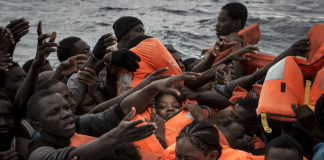 Rescue boat with hundreds of migrants on board beg for port