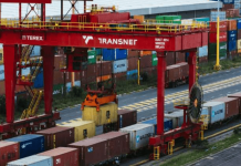 """South Africa's state-owned ports and freight-rail company, Transnet, has declared force majeure after disruptions caused by a cyberattack last week. The measure was imposed because of the effects of the July 22 attack on Durban, Ngqura, Port Elizabeth and Cape Town ports, according to a statement released by Transnet. The company also said that it will continue to require hard copies of some shipping documents until their system is fully operational. """"Transnet, including Transnet Port Terminals, experienced an act of cyber-attack, security intrusion, and sabotage, which resulted in the disruption of normal processes,"""" it said. """"Investigators are currently determining the exact source of the cause of compromise and extent of the ICT data security breach or sabotage."""" The embargo threatens to have a ripple effect on Africa's most industrialized economy. In Durban, 60% of the nation's loads are lifted by Transnet. Further complicating the problem is instability caused by lockdowns, as well as the effects of this month's deadly riot after the jailing of former president Jacob Zuma for corruption charges. """"Some applications may continue to run slowly over the next few days, while monitoring continues. All operating systems will be brought back in a staggered manner, to minimize further risks and interruptions,"""" Transnet said in a statement."""